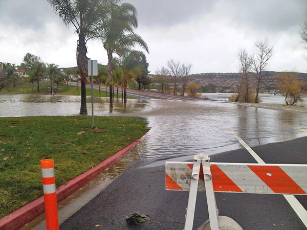 ABC7 viewer Paul Stoltz sent in this photo of the main Canyon Lake causeway flooded on Wednesday, Dec. 22, 2010.   When You Witness breaking news, or even something extraordinary, send pictures and video to video@myabc7.com, or send them to @abc7 on Twitter <span class=meta>(ABC7 viewer Paul Stoltz)</span>