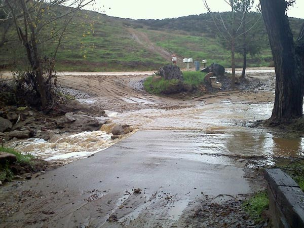 ABC7 viewer Evelyn Diaz sent in this photo of a creek overflowing in Cottonwood Canyon on Wednesday, Dec. 22, 2010.  When You Witness breaking news, or even something extraordinary, send pictures and video to video@myabc7.com, or send them to @abc7 on Twitter <span class=meta>(ABC7 viewer Evelyn Diaz of Menifee)</span>