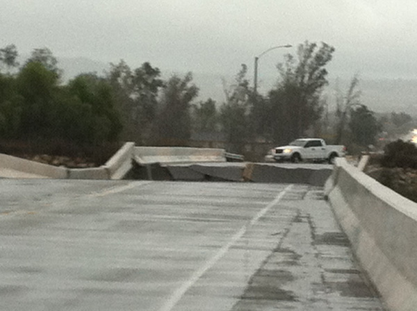 ABC7 viewer Joyce Acosta sent in this photo of a road that buckled due to the storm in Highland on Wednesday, Dec. 22, 2010.   When You Witness breaking news, or even something extraordinary, send pictures and video to video@myabc7.com, or send them to @abc7 on Twitter <span class=meta>(ABC7 viewer Joyce Acosta)</span>