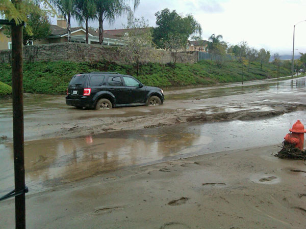 ABC7 viewer Larry Beach sent in this photo of an SUV stuck in mud on Highland Avenue in Highland, Calif., on Wednesday, Dec. 22, 2010.   When You Witness breaking news, or even something extraordinary, send pictures and video to video@myabc7.com, or send them to @abc7 on Twitter <span class=meta>(ABC7 viewer Larry Beach)</span>