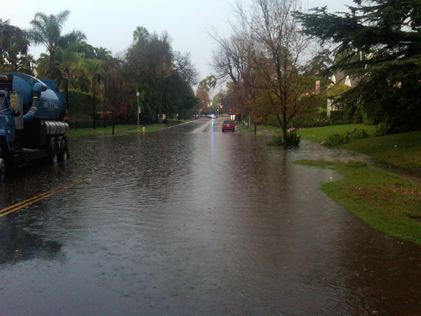 ABC7 viewer Bruce Walker sent in a photo of Rossmore Avenue flooded on Wednesday, Dec. 22, 2010.  When You Witness breaking news, or even something extraordinary, send pictures and video to video@myabc7.com, or send them to @abc7 on Twitter <span class=meta>(ABC7 viewer Bruce Walker)</span>