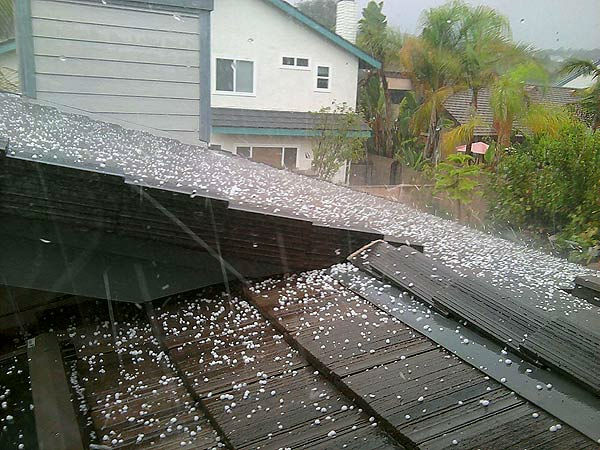 "<div class=""meta ""><span class=""caption-text "">ABC7 Viewer Kaylee B. shows a roof peppered by hail that fell in Dana Point on Saturday, Sept. 10, 2011. (Kaylee B.)</span></div>"