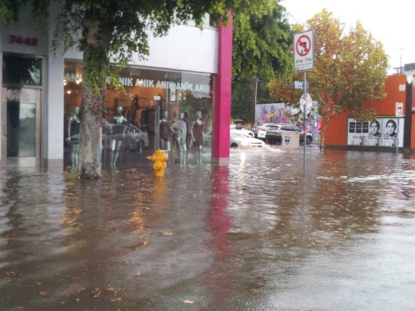 ABC7 viewer Ami sent in this photo of rain flooding the 7000 block of Melrose Avenue in Los Angeles, Calif. on Sunday Nov. 20, 2011.  When You Witness breaking news, or even something extraordinary, send pictures and video to video@myabc7.com, or send them to @abc7 on Twitter <span class=meta>(KABC photo&#47;  Ami)</span>