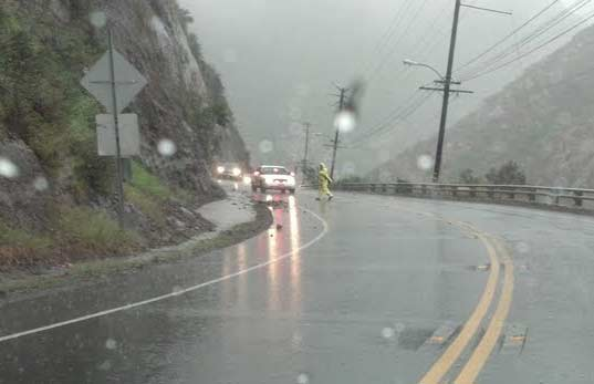 "<div class=""meta ""><span class=""caption-text "">ABC7 viewer Howard Eigenberg sent in this photo of a CHP officer clearing debris from a rock slide in Malibu Canyon as a powerful storm passed over Southern California on Sunday March, 25, 2012.  When You Witness breaking news, or even something extraordinary, send pictures and video to video@myabc7.com, or send them to @abc7 on Twitter or our ABC7 Facebook page. (ABC7 viewer Howard Eigenberg)</span></div>"