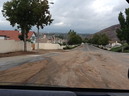 ABC7 viewer Jennifer Hernandez sent us this photo of mud and debris off of Canyon Crest Lane in the neighborhood of Southridge in Fontana, Friday, Oct. 12, 2012 following a bout of rain that hit Southern California on Thursday, Oct. 11, 2012.    <span class=meta>(ABC7 viewer Jennifer Hernandez)</span>