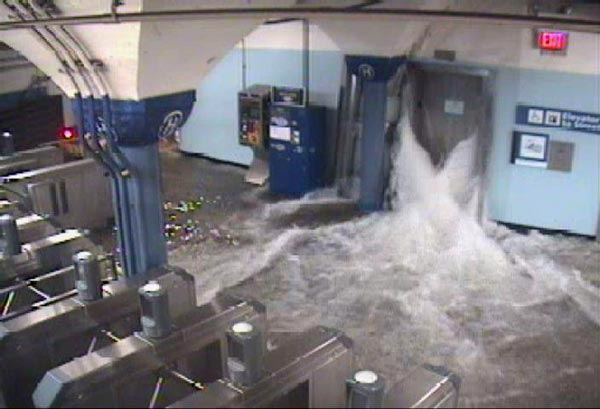 Flood waters rush in to the Hoboken PATH station through an elevator shaft during hurricane Sandy, on Monday, Oct. 29, 2012.