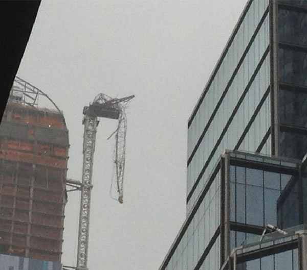 A crane is seen dangling on 57th Street and 7th Avenue in Manhattan on Monday, Oct. 29, 2012, as Hurricane Sandy approaches.