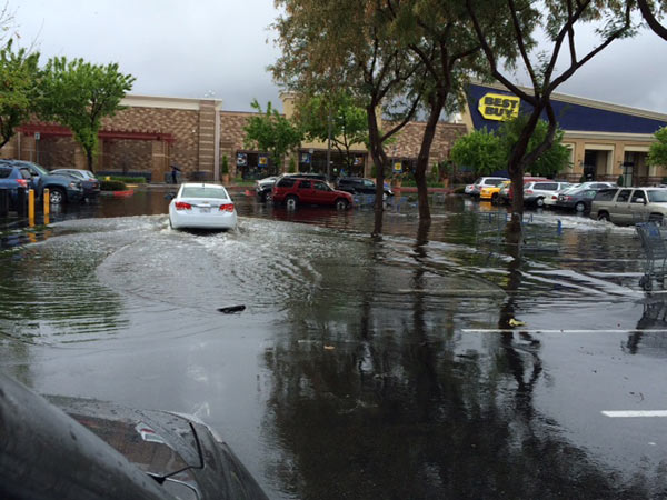ABC7 viewer Johanna Thompson sent in this photo of a flooded parking lot in Chino Spectrum Marketplace via email on Friday, Feb. 28, 2014. When You Witness breaking news, or even something extraordinary, send pictures and video to video@abc7.com, or post them to the ABC7 Facebook page or to @abc7 on Twitter  <span class=meta>(Johanna Thompson)</span>