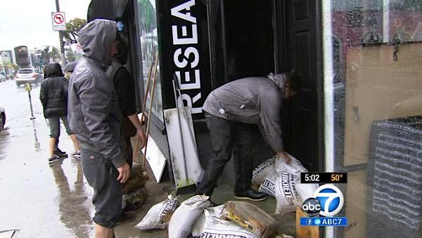 Sand bags are placed at the front of a business on Melrose Avenue in Hollywood to prevent overflow from a powerful storm that passed over Southern California on Sunday March, 25, 2012.