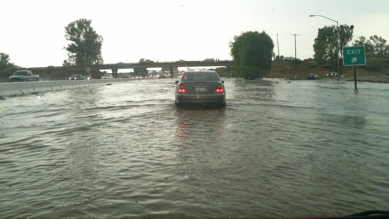 ABC7 viewer Mike Maxson sent in this photo of flooding on the 60 Freeway at Redlands Boulevard in Moreno Valley on Thursday, August 30, 2012. <span class=meta>(ABC7 viewer Mike Maxson)</span>