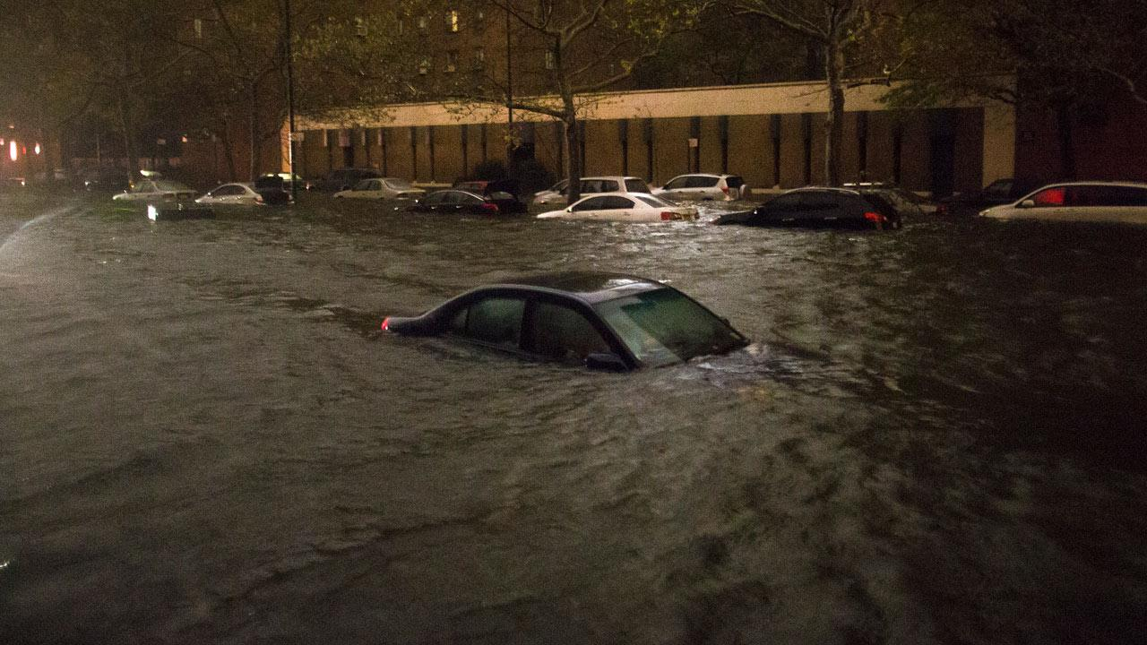 A vehicle is submerged on 14th Street near the Consolidated Edison power plant, Monday, Oct. 29, 2012, in New York.John Minchillo