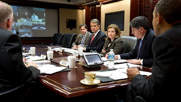 President Barack Obama receives an update from officials via teleconference on the ongoing response to Hurricane Sandy, in the Situation Room of the White House, Oct. 30, 2012.