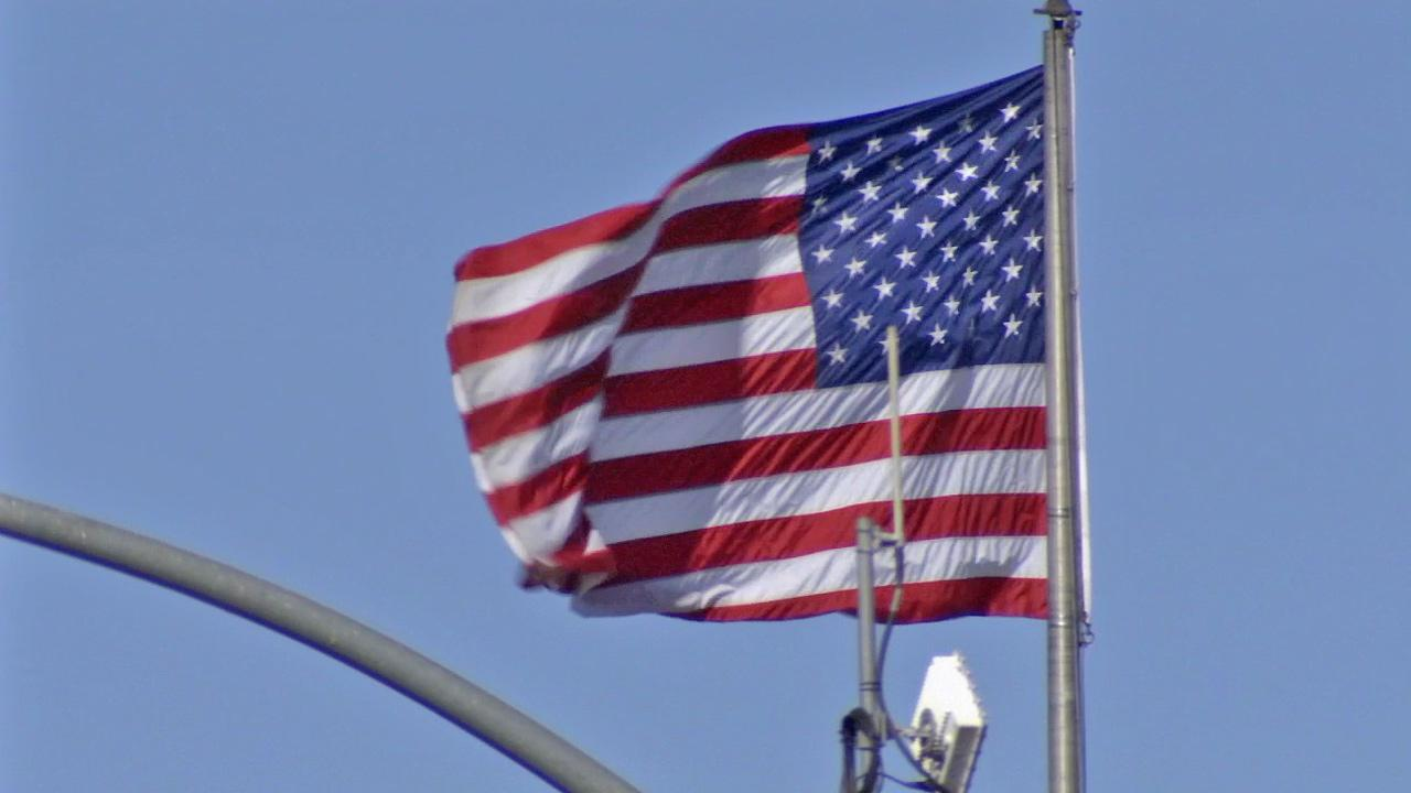 An American flag is seen blowing in the wind.
