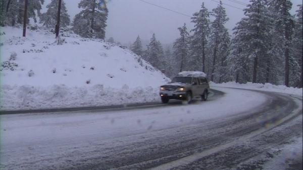 New snow in local mountains; chains required