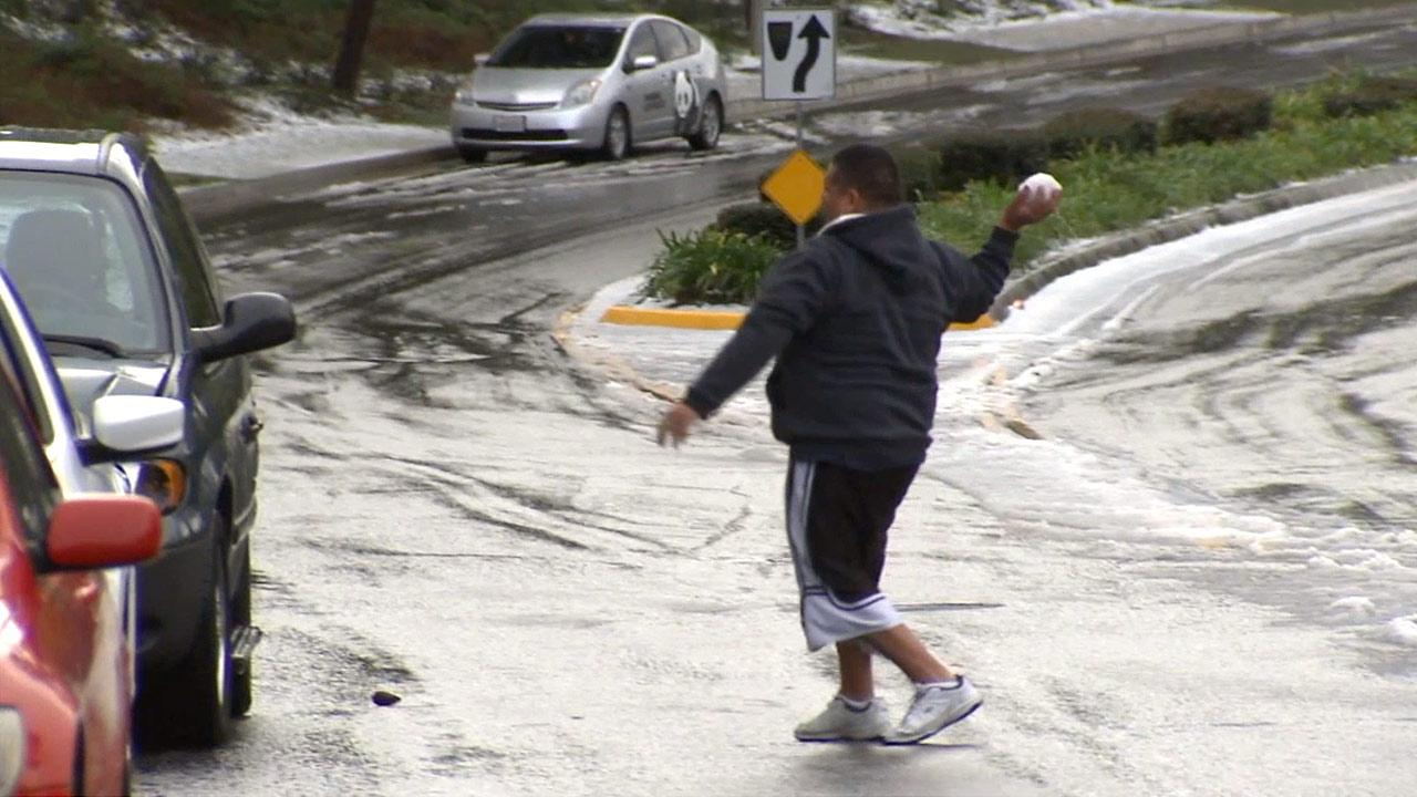 A cold storm system passing over Southern California dusted some L.A. County neighborhoods with snow on Sunday, Dec. 30, 2012.