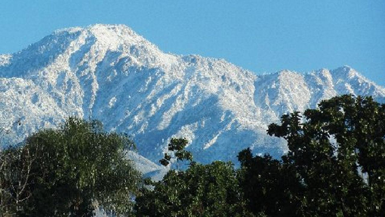 An ABC7 viewer sent us this photo of snow in the mountains above Cucamonga following a storm that hit Southern California on Friday, Feb. 8, 2013. <span class=meta>(ABC7 viewer)</span>