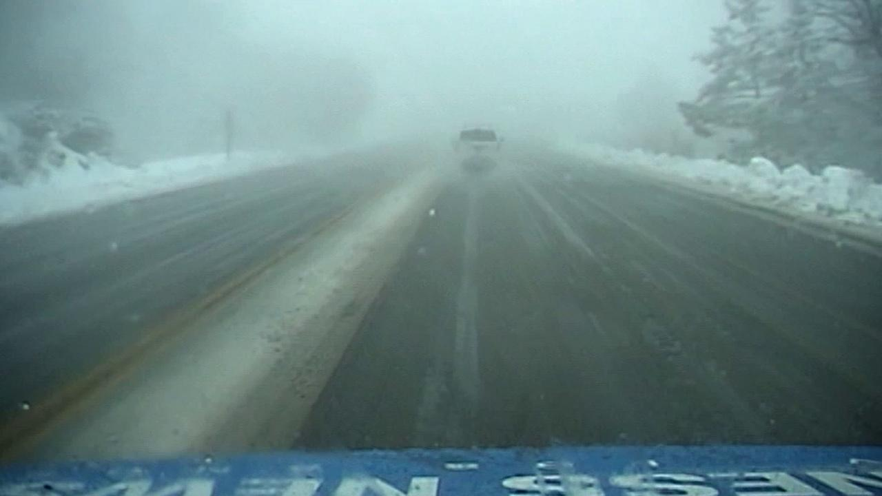A snowy Highway 18 is seen from an Eyewitness News truck in San Bernardino County on Friday, March 8, 2013.