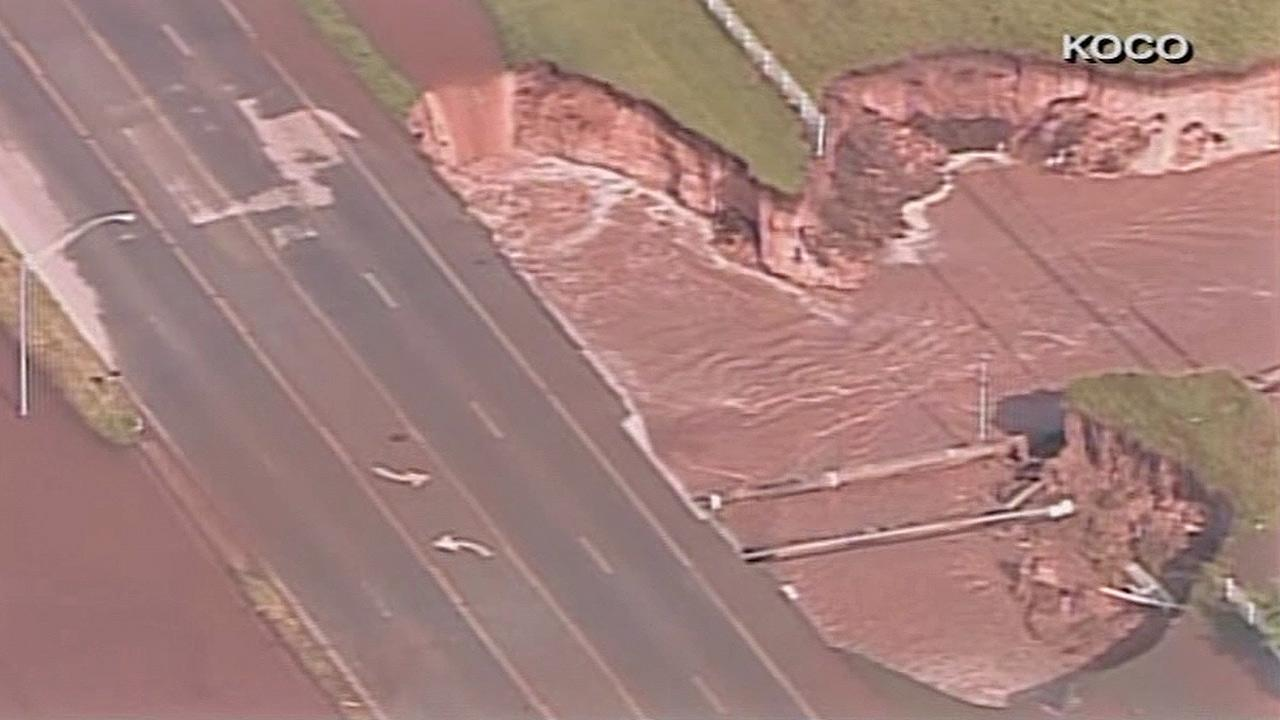 A massive sinkhole opened up along a road in Oklahoma City after multiple tornadoes stuck the area on Friday, May 31, 2013.KOCO