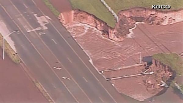 A massive sinkhole opened up along a road in Oklahoma City after multiple tornadoes stuck the area on Friday, May 31, 2013.