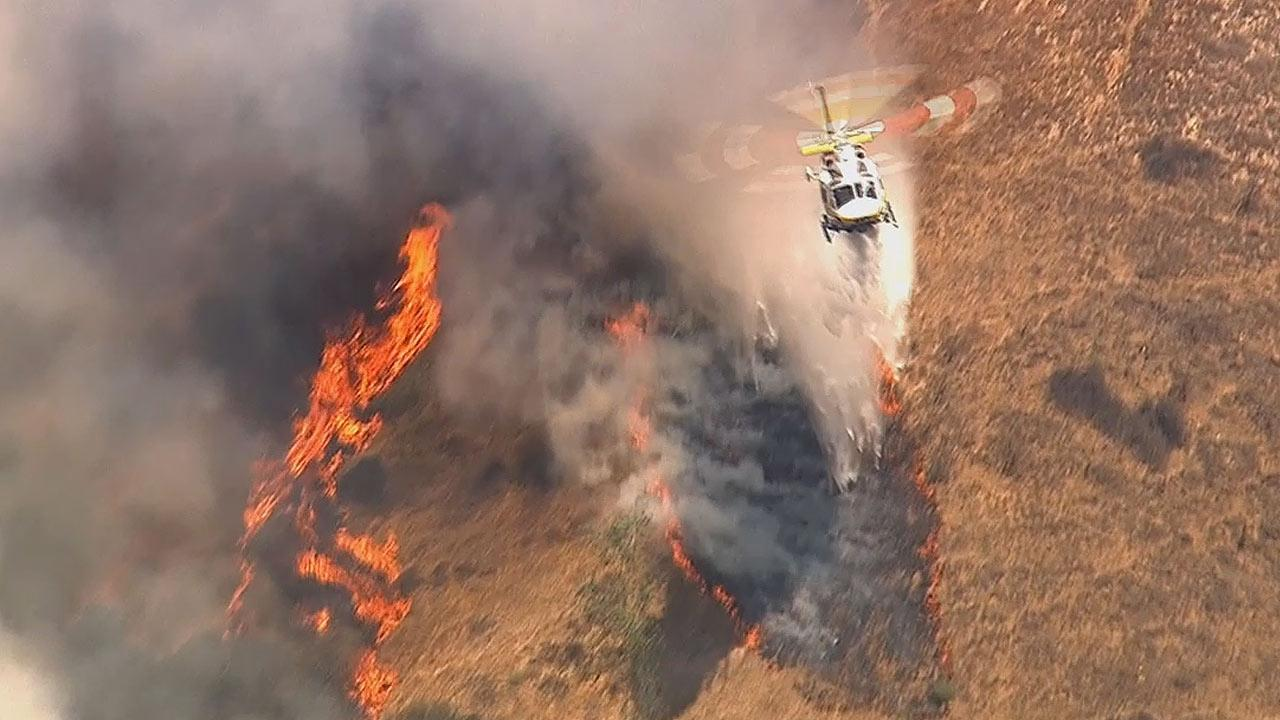 A brush fire was burning near Broken Spur Lane and Rough Rider Road in La Verne Friday afternoon.