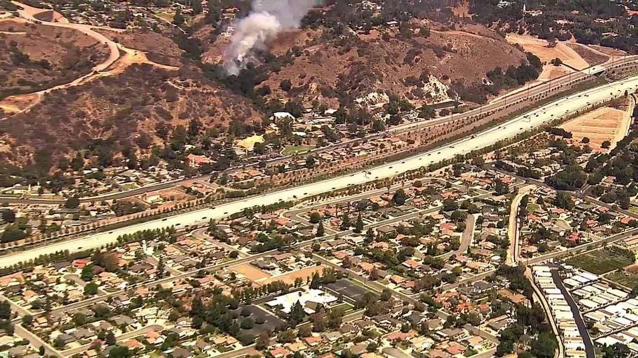 A brush fire burning near Broken Spur Lane and Rough Rider Road in La Verne prompted evacuations Friday afternoon.