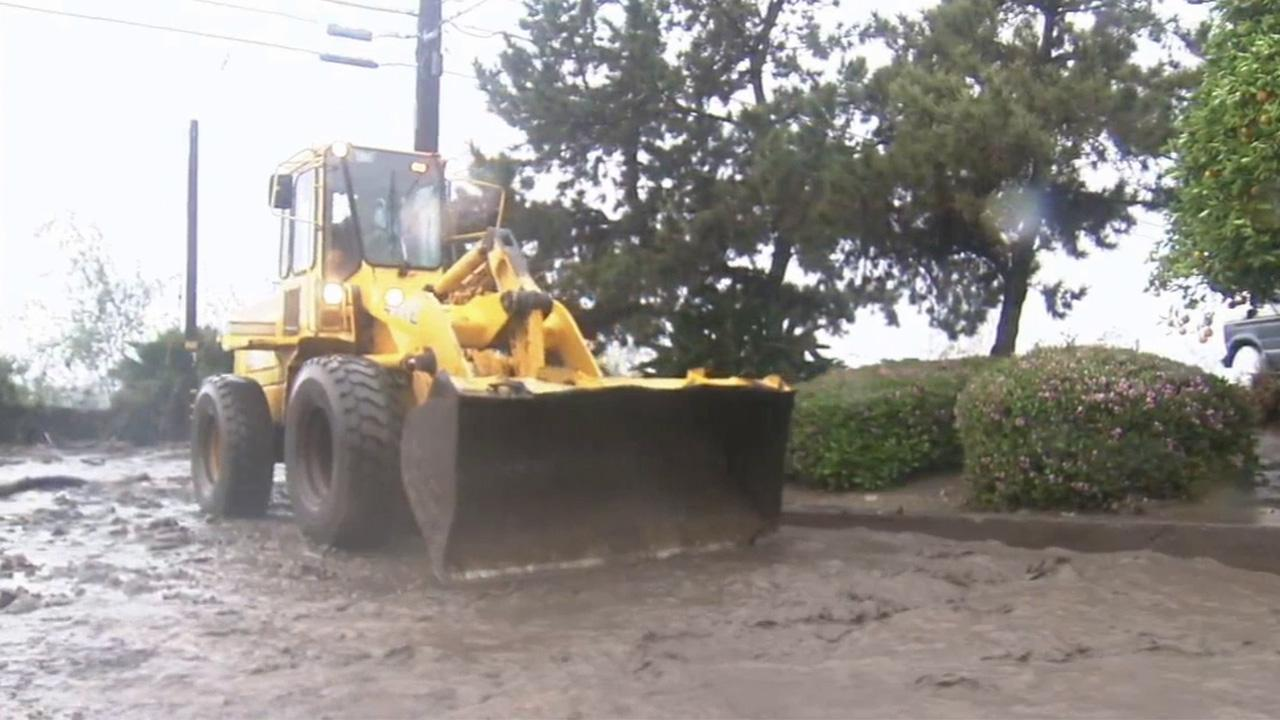 A bulldozer in Glendora clears debris during a rainstorm on Friday, Feb. 28, 2014.