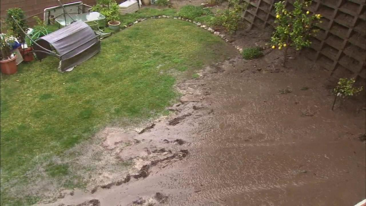 Mud flowed into the backyard of an Azusa home on Friday, Feb. 28, 2014.
