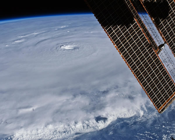 In this photograph captured with a digital SLR camera by NASA astronaut Douglas Wheelock, Earl had a distinct eye that spanned about 17 miles &#40;28 kilometers&#41;. Most of the storm had a seemingly uniform top, though the bottom edge of the image gives some sense of the towering thunderheads forming over the ocean. <span class=meta>(NASA&#47; Douglas Wheelock)</span>