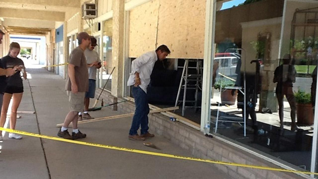 People outside a shop assess the damage caused by a swarm of earthquakes that struck the Imperial County city of Brawley at the U.S.-Mexico border on Sunday, Aug. 26, 2012. <span class=meta>(ABC7 viewer Jason Cobb)</span>
