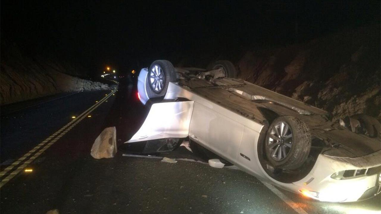 The Brea Police Department shared this photo of a car that overturned because of a rockslide following a 5.1 earthquake centered near La Habra on Friday, March 28, 2014.Brea Police Department