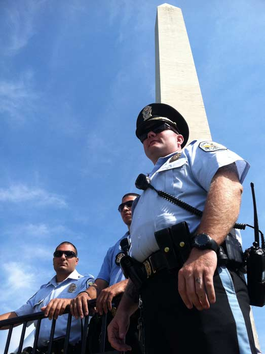 The Washington National Monument is shown guarded by police following the 5.8-magnitude earthquake that struck Virginia on Tuesday, August 23, 2011. <span class=meta>(KABC)</span>
