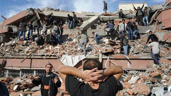 People try to save people trapped  under debris in Tabanli village near the city of Van after a powerful earthquake struck eastern Turkey Sunday Oct. 23, 2011, collapsing some buildings and causing a number of deaths, an official said.