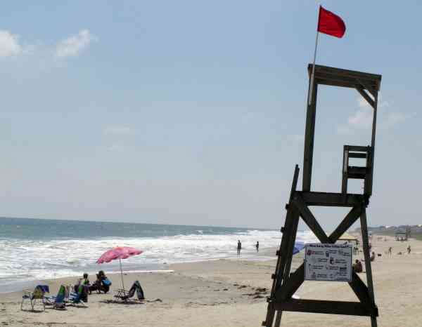 Red flags warn swimmers from the water at Kure Beach, N.C., as waves increase from Hurricane Earl beyond the horizon on Wednesday, Sept. 1, 2010.  <span class=meta>(AP Photo&#47; Bruce Smith)</span>