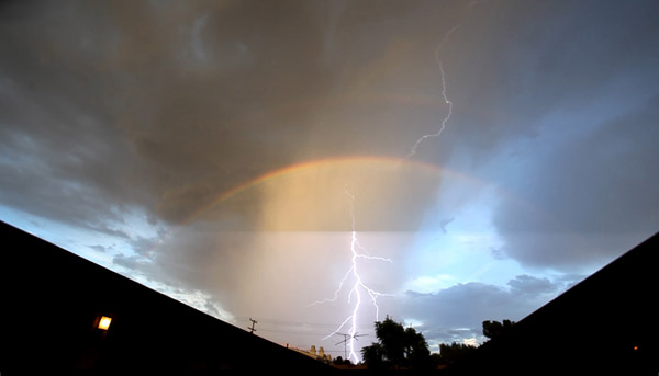 ABC7 viewer Joseph Merkens sent in this photo of lightning and a rainbow in Montrose following a rain storm on Thursday, Sept. 30, 2010.  &#160;When you witness breaking news happen, send your photos to video@myabc7.com, or send them to @abc7 on Twitter <span class=meta>(ABC7 viewer Joseph Merkens)</span>