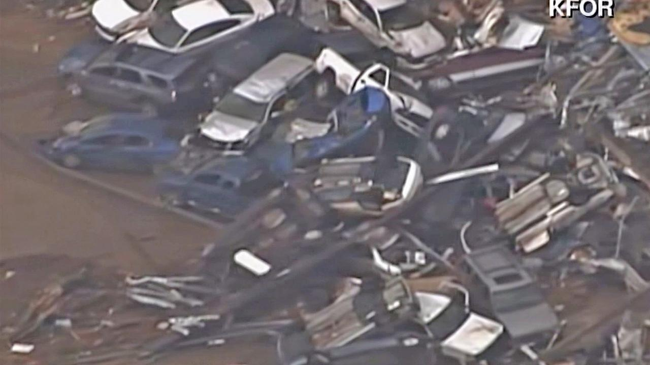 Cars are seen piled after a tornado struck a neighborhood in Moore, Okla., on Monday, May 20, 2013.