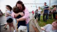 Families reunite following a tornado that struck Moore, Okla., on Monday, May 20, 2013.