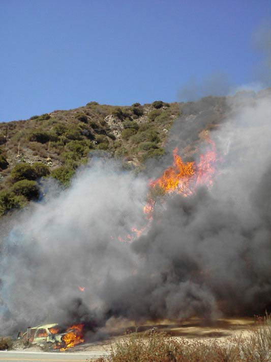 "<div class=""meta ""><span class=""caption-text "">ABC7 viewer Alan Orozco sent this photo of a fire-gutted vehicle, a possible source of a wildfire burning in the San Gabriel Mountains above Glendora on Sunday, Sept. 2, 2012. </span></div>"