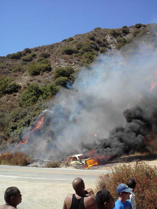 ABC7 viewer Alan Orozco sent this photo of a fire-gutted vehicle, a possible source of a wildfire burning in the San Gabriel Mountains above Glendora on Sunday, Sept. 2, 2012.