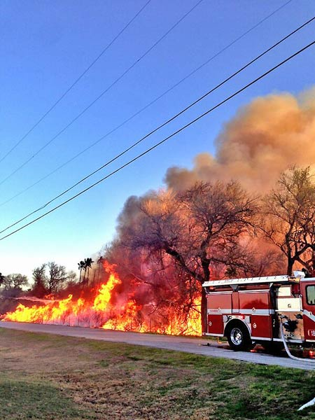 An ABC7 viewer tweeted us this picture of a brush fire burning near homes in Jurupa Valley on Thursday, Feb. 28, 2013. <span class=meta>(twitter.com&#47;bhartman109)</span>