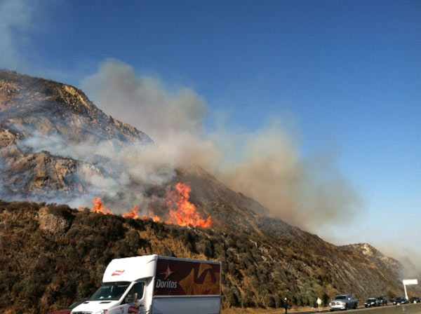 "<div class=""meta ""><span class=""caption-text "">A brush fire broke out near the 101 Freeway in Camarillo Thursday, May 2, 2013. (Jessica Holt)</span></div>"