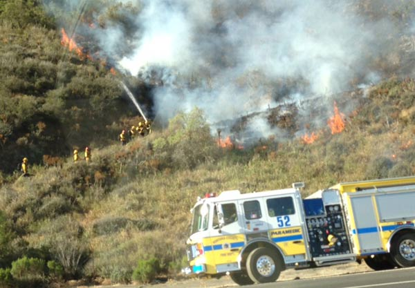 ABC7 viewer Sreeni Alavarti sent in this photo of crews fighting a wildfire burning near the 101 Freeway in Camarillo on Thursday, May 2, 2013.  When You Witness breaking news, or even something extraordinary, send pictures and video to video@myabc7.com, or send them to @abc7 on Twitter <span class=meta>(KABC-TV &#47; Sreeni Alavarti)</span>