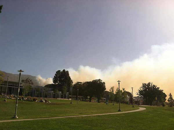 Smoke from a brush fire burning north of Rancho Cucamonga is seen from Chaffey College on Wednesday, April 30, 2014. <span class=meta>(ABC7 viewer Trisha Albertsen)</span>