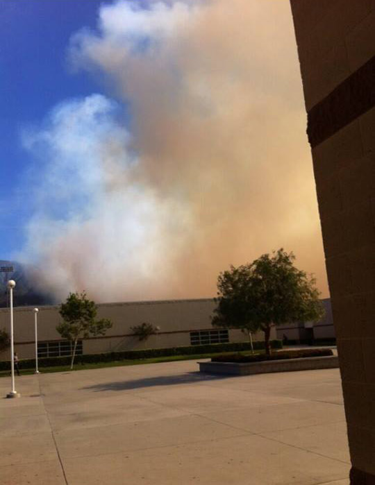 Smoke from a brush fire burning north of Rancho Cucamonga is seen from Los Osos High School in Alta Loma on Wednesday, April 30, 2014. <span class=meta>(ABC7 viewer Denise Smith Zellar)</span>