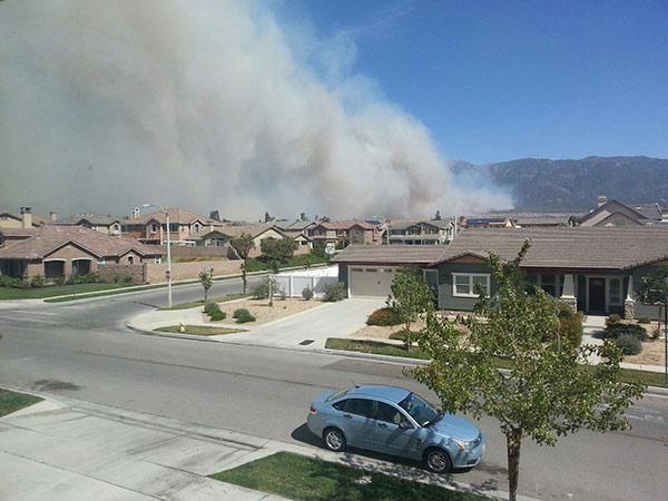 ABC7 Photographer Dave Wood shot this photo of smoke from a brush fire near Rancho Cucamonga on Wednesday, April 30, 2014. <span class=meta>(Dave Wood)</span>