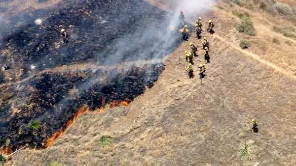 Crews attempt to set a perimeter around a brush fire that broke out in the hills of Castaic along Interstate 5 on F