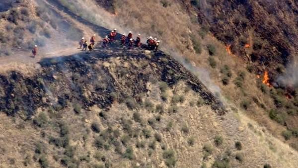 Crews work to contain a brush fire that broke out in the hills of Castaic