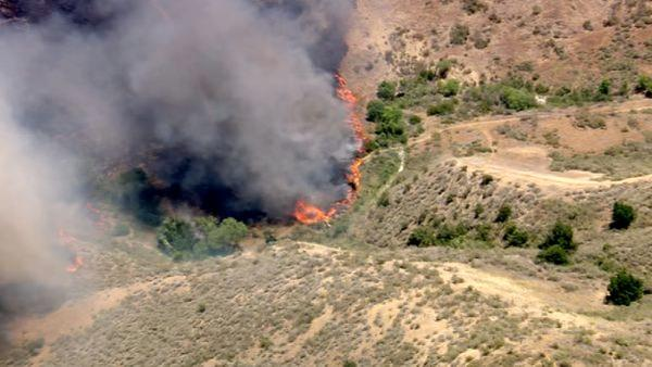 A brush fire burns in the Castaic hills on Friday, June 8, 2012. Fanned by winds, the blaze
