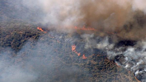Smoke rises above the hills of Castaic, where a brush fire broke out along Interstate 5 on Friday, June 8, 2012. Fanned by winds, the blaze grew from 3 acres to more than 50 in less than three hours.