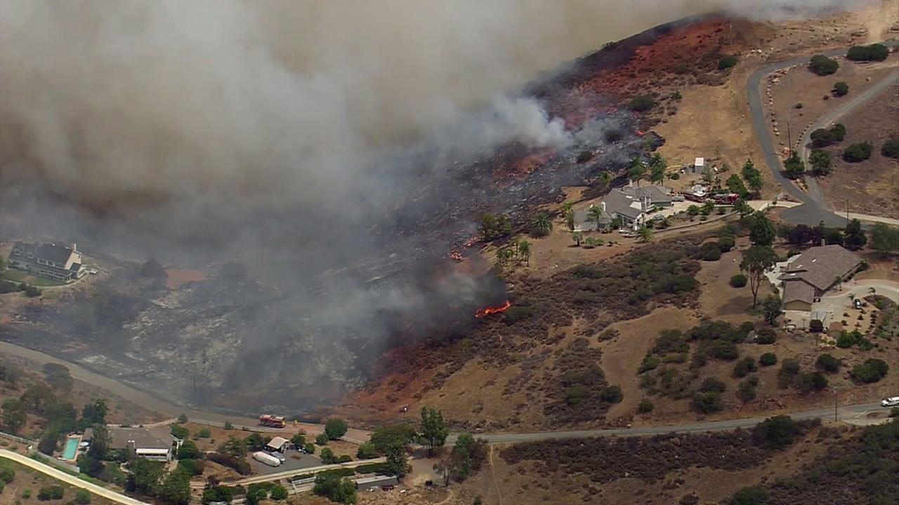 A brush fire threatened residences in Murrieta on Wednesday, Aug. 1, 2012.