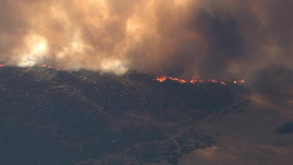 A large brush fire burns in Aguanga, just east of Temecula, on Tuesday, Aug. 14, 2012. Several homes
